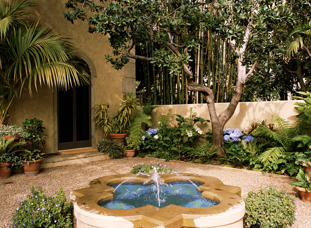 Mediterranean d cor touring a home in the hollywood for Mediterranean garden design