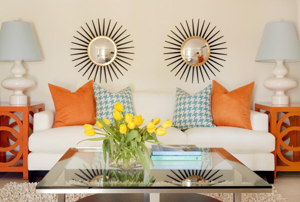 tobi fairley2 suburst mirror orange pillows white walls decor modern retro style