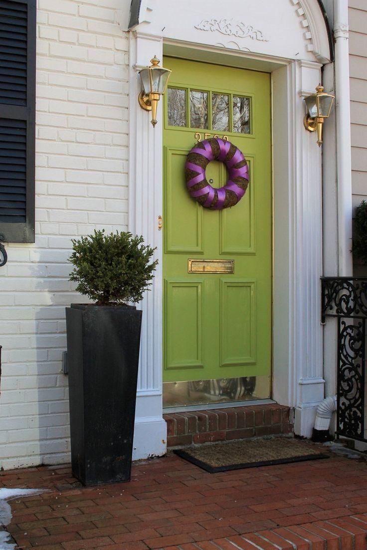 green front door gold mail slot kickboard
