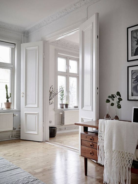 glamorous white apartment with french style doors molding decor