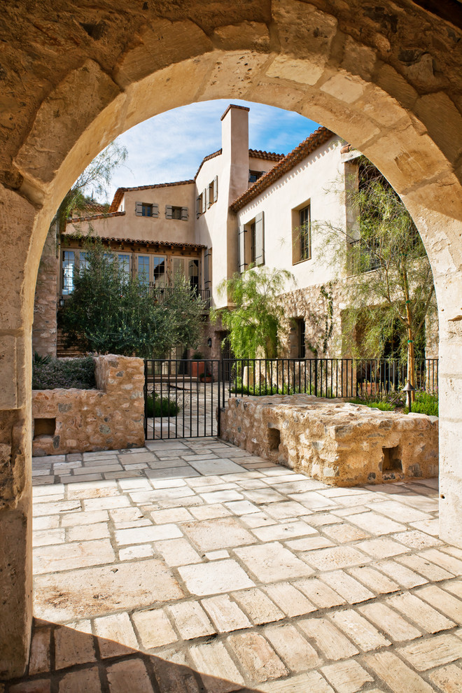 Picture your life in tuscany in a mediterranean style home for Italian mediterranean architecture
