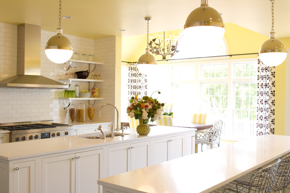 White kitchen cabinets light blue walls for Blue and yellow kitchen decorating ideas