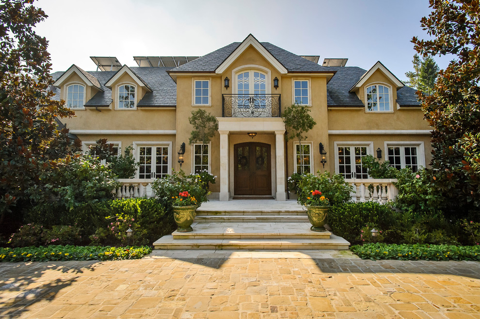 5 mediterranean-exterior home french revival provincial cream stucco better decorating bible blog balcony walkway