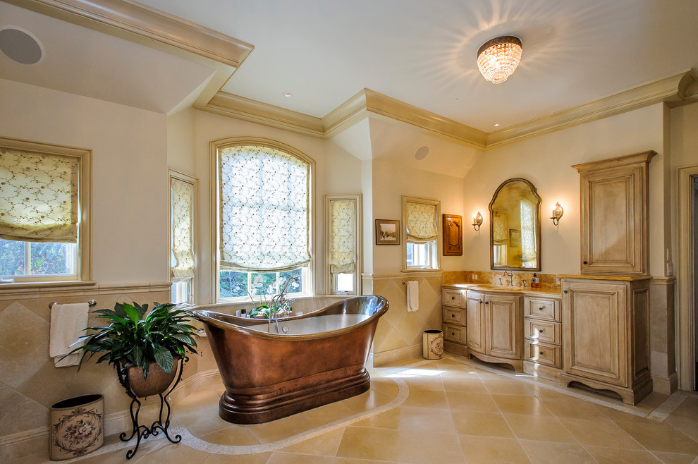 brass bathtub bathroom tiles molding mediterranean home french revival provincial cream sofas yellow curtains better decorating bible blog balcony walkway