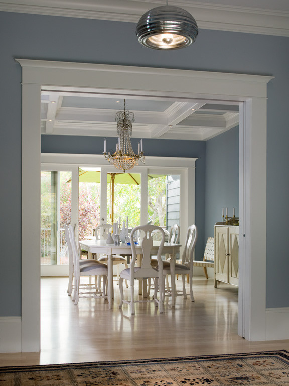 dijejau poage construction dining room light gray blue walls wooden floors gold chandelier better decorating bible blog interiors white chairs waffle ceiling