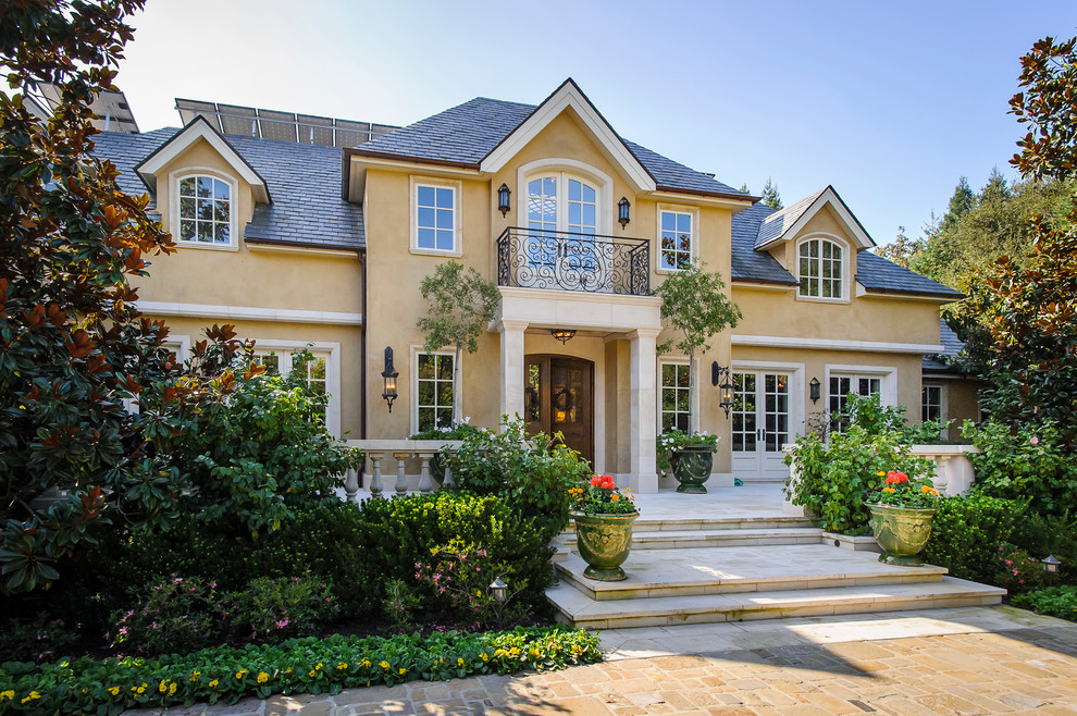 mediterranean-exterior home french revival provincial cream stucco better decorating bible blog balcony walkway