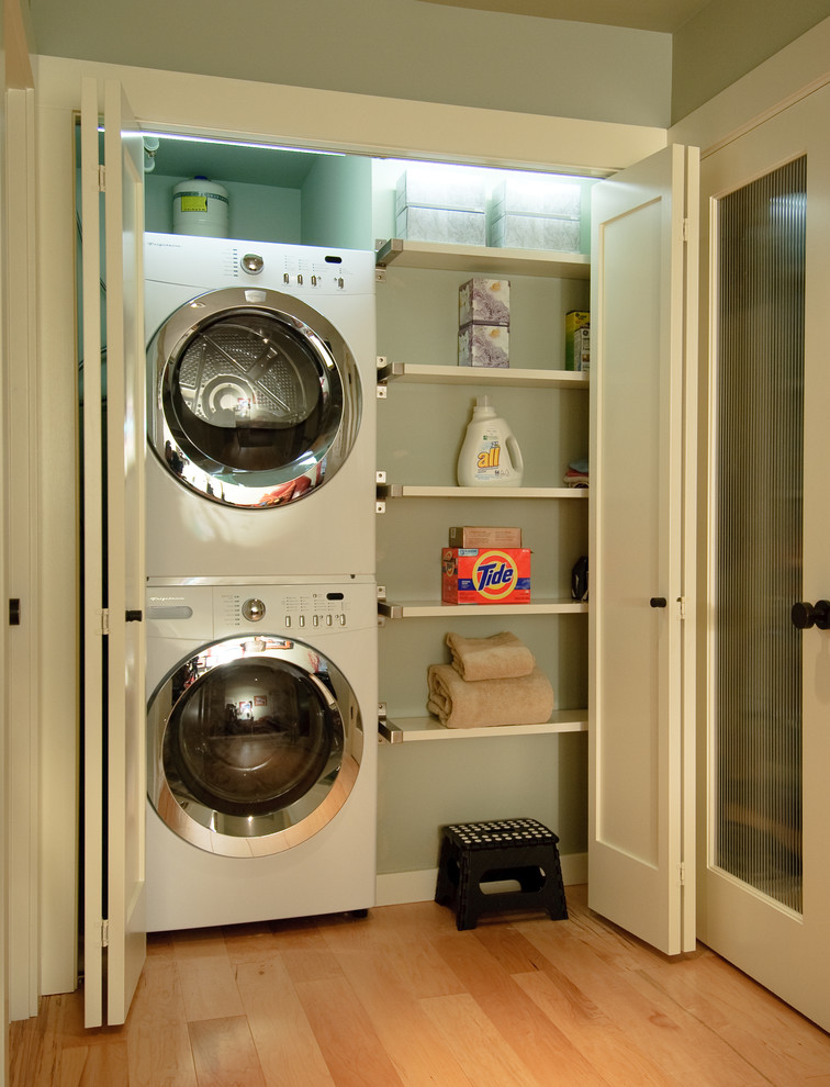 Try this organize your small home with accordion doors for Small laundry design