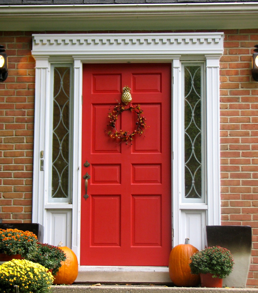 red door paint makeover fall halloween pumpkin wreath traditional-exterior