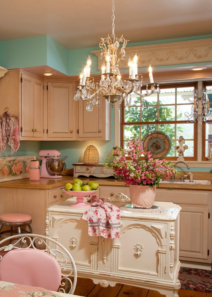 floral pin up kitchen retro 50s style pink turqouise blue green chandelier chairs better decorating bible blog