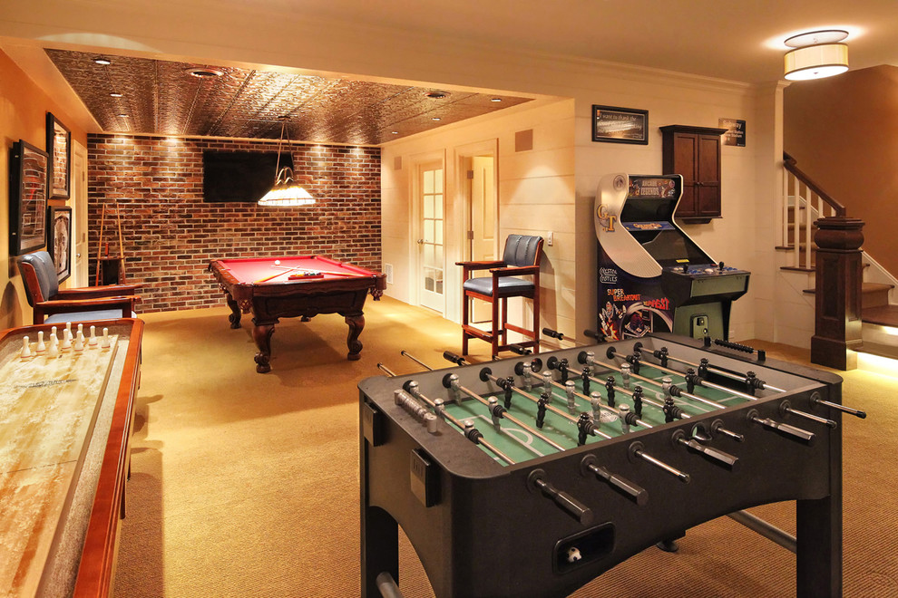 the game room has a pool table air hockey table foosball