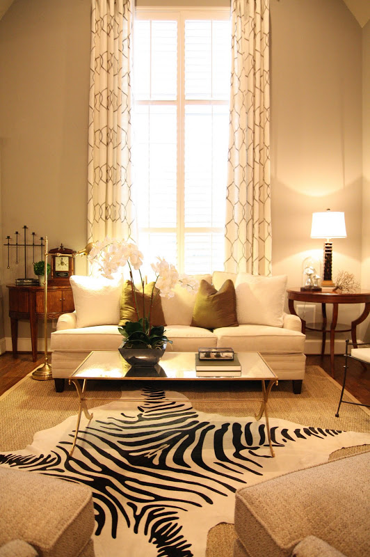gold iron coffee table decor zebra hide gur rug white sofa high ceilings bee hive pattern curtains better decorating bible blog