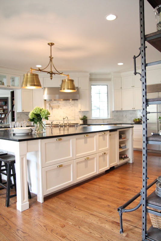 pearl white kitchen gold lamp home reno renovation drawer pulls storage black countertop decorating budget