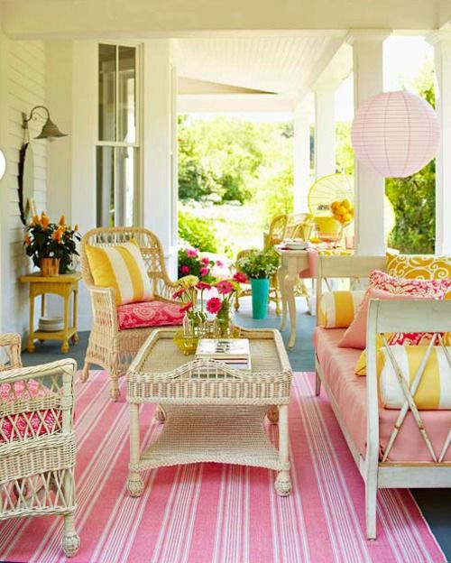 retro girly decor porch pink stripes rug rattan furniture hollywood regency