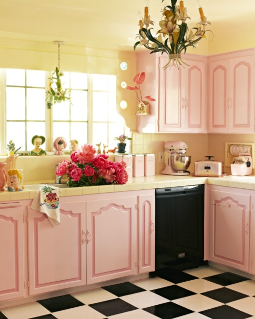 retro pin up vintage decor kitchen black and white floor tiles pink cabinetry chandelier better decorating bible blog