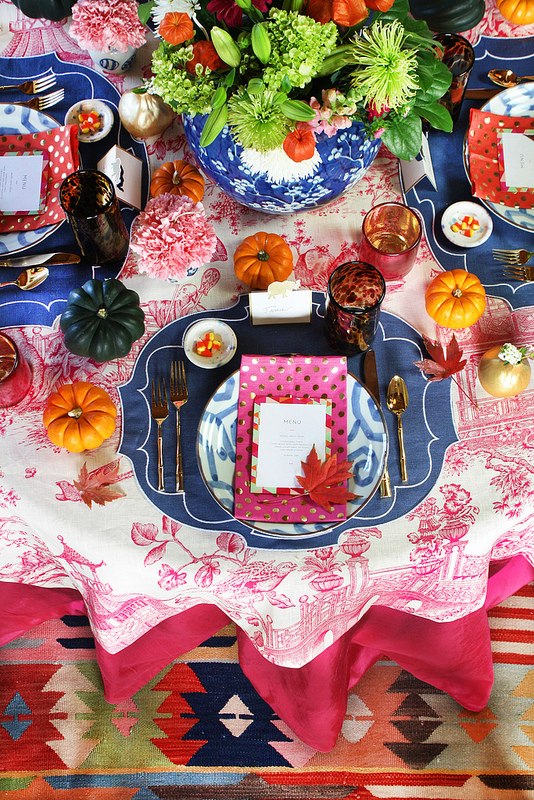 3 thanksgiving table set up tablescape ideas gold sunburt mirror chinese print fuschia table cloth blue lamps chinoiserie better decorating bible blog