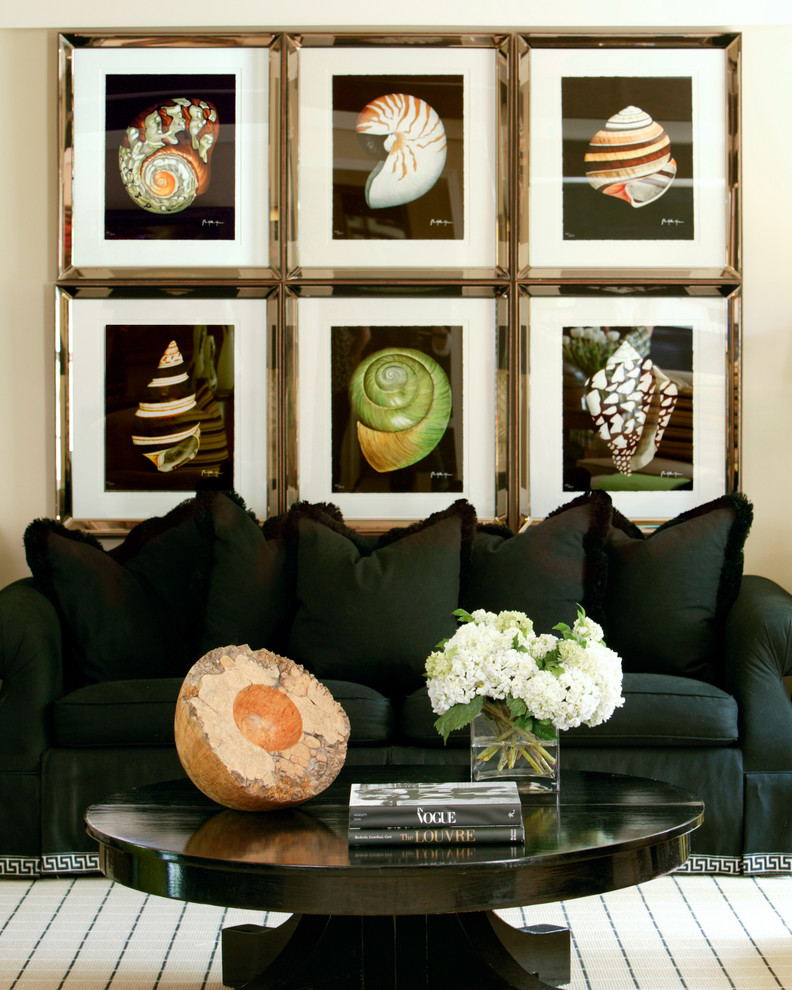 feature wall frames shells black sofa traditional-family-room