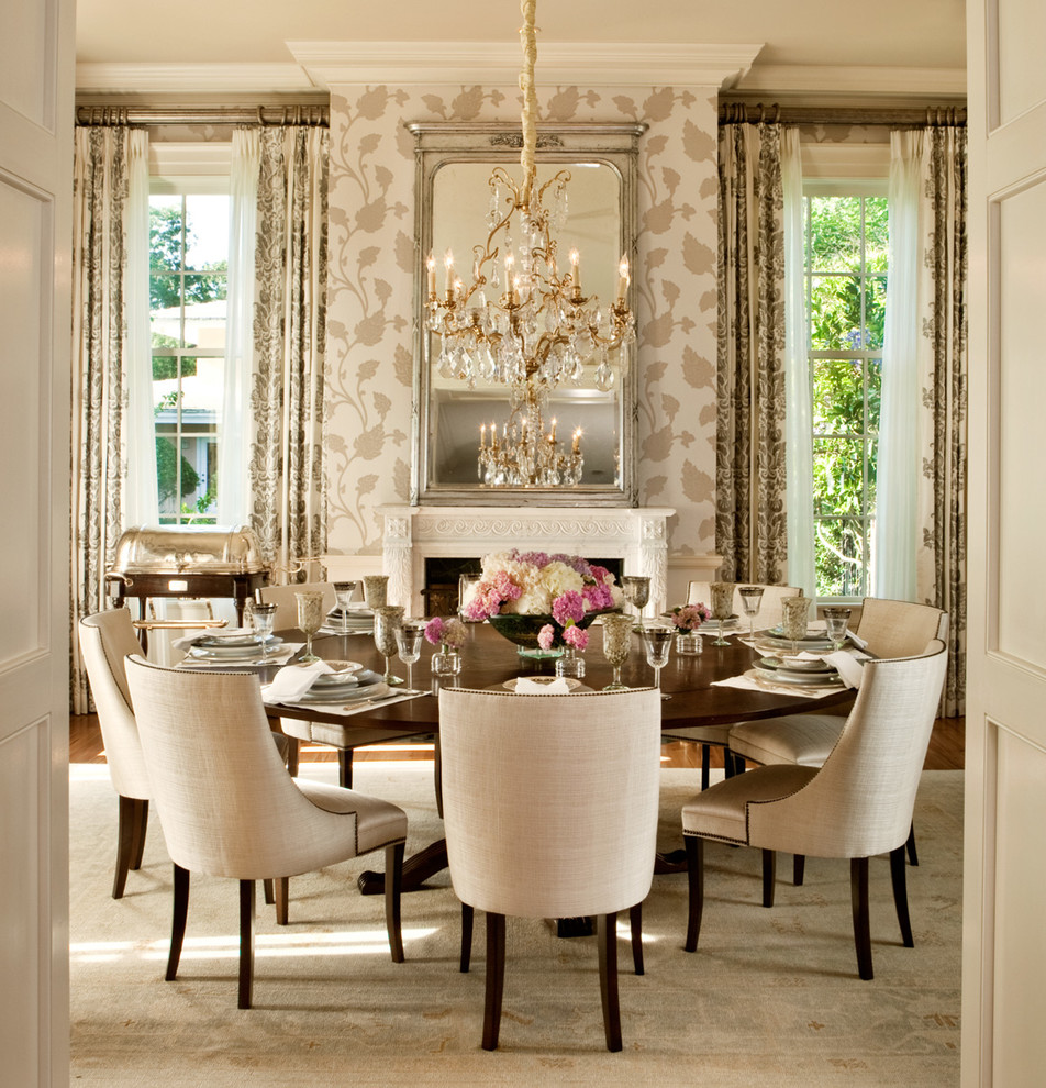 gorgeous dining room gold chandelier floral wallpaper chairs tufted studs roses taupe gray walls rug transitional-dining-room