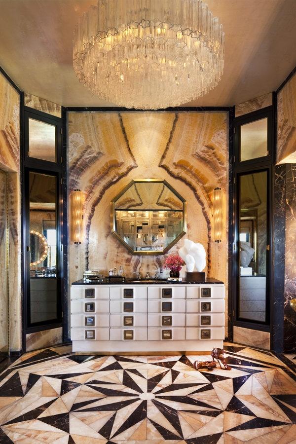 la racked luxurious bathroom gold chandelier mosaic tiles marble decor