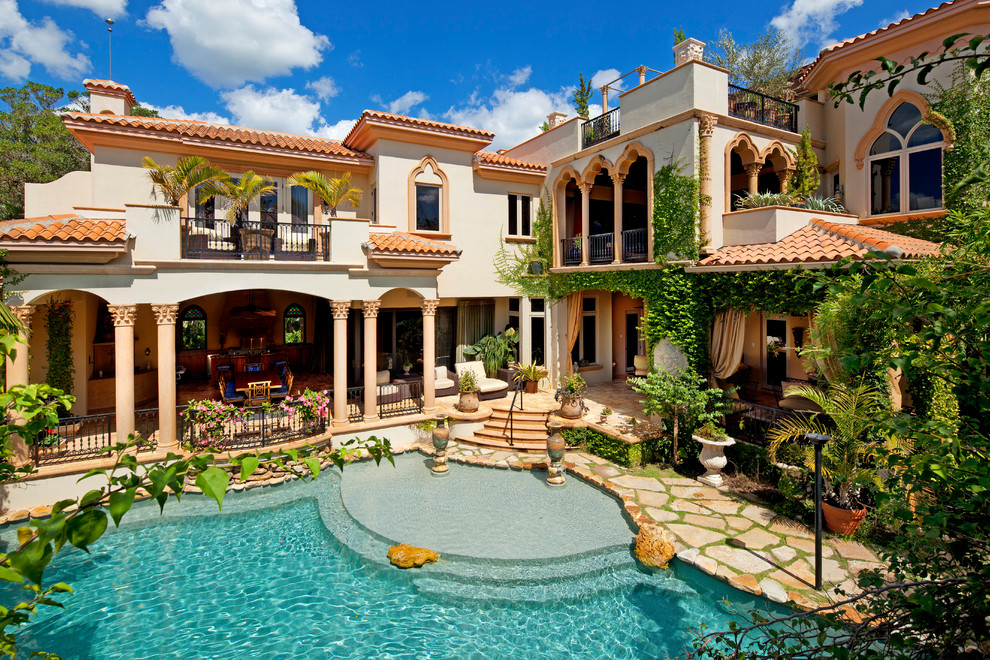 Home tour impeccable mediterranean waterfront home for Luxury mansions for sale in florida