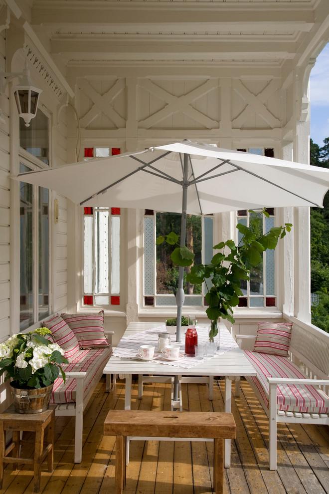 acr villa skovly outdoo balacony dining Traditional-Porch