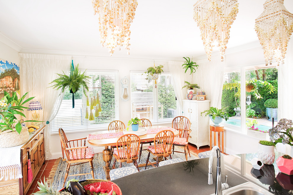 sea shell chandeliers venetian blinds hanging plants country style Eclectic-Dining-Room