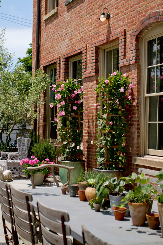 1 red brick loft terrace roof garden trees flowers dining set apartment city
