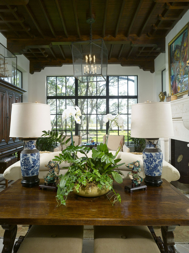 Mediterranean-Living-Room blue and white vase maps candle chandelier huge floor length windows