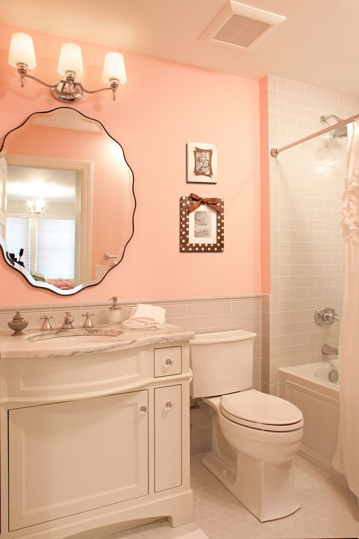 beveled mirror pink washroom gray subway tiles