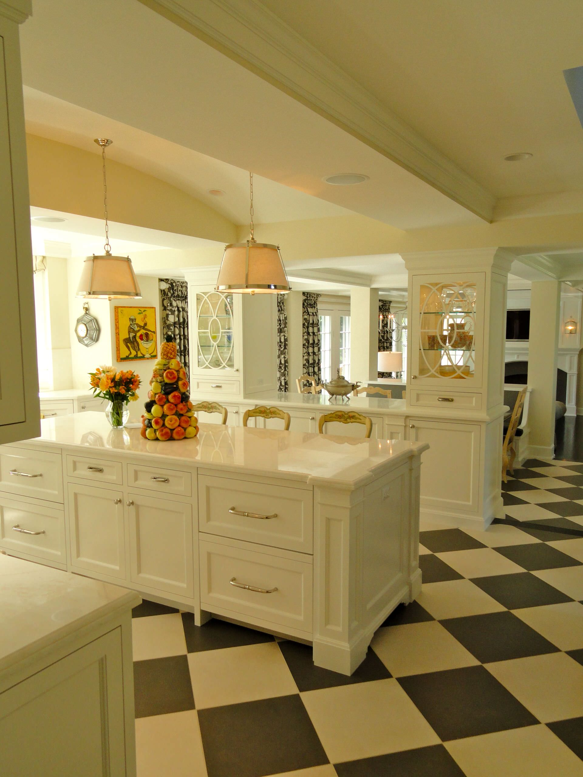 black and white titles kitchen white counter tops marble white cabinets open layout hanging lamps decorating