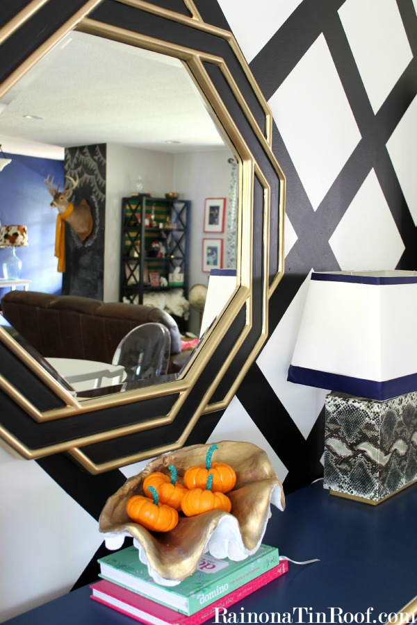 fall home tour decorating diea snake skin lamp black and white striped walls gold mirror sparkle painted mini pumpkins