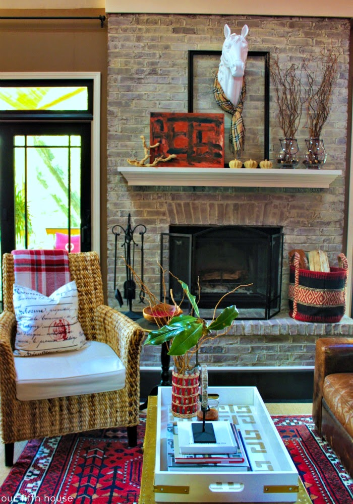 fall living room thanksgiving decor ideas whicker chair horse head antlers fireplace above mantel