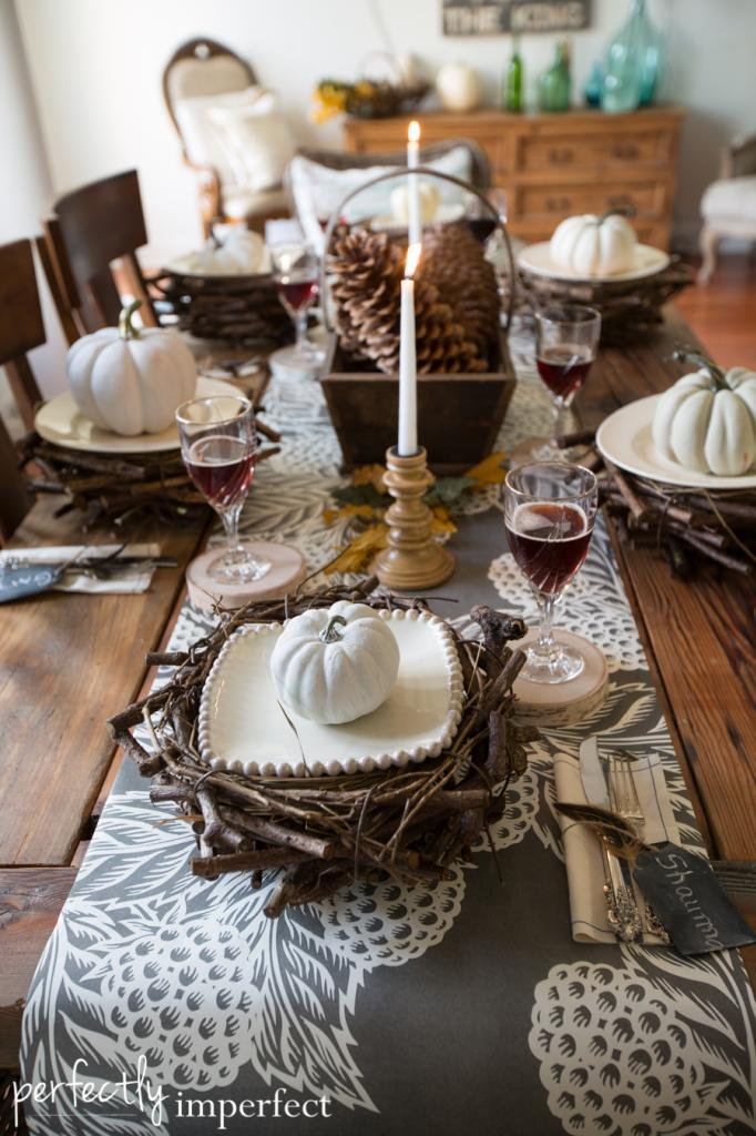 fall thanksgiving home tour tablescape centerpiece pine cones candles idea sliced wood glass place mats country style