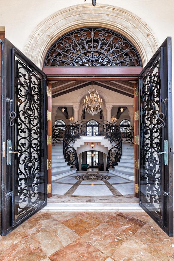 double door wrought iron entrance marble decor
