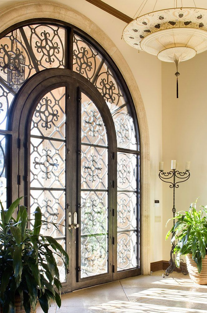 wrought iron glass front door entrance mansion
