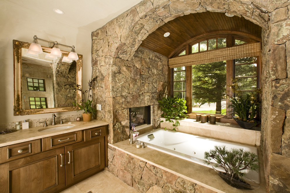 bathtub wall arch covered in river stone rocks country cottage style ranch house better decorating bible blog rustic interior