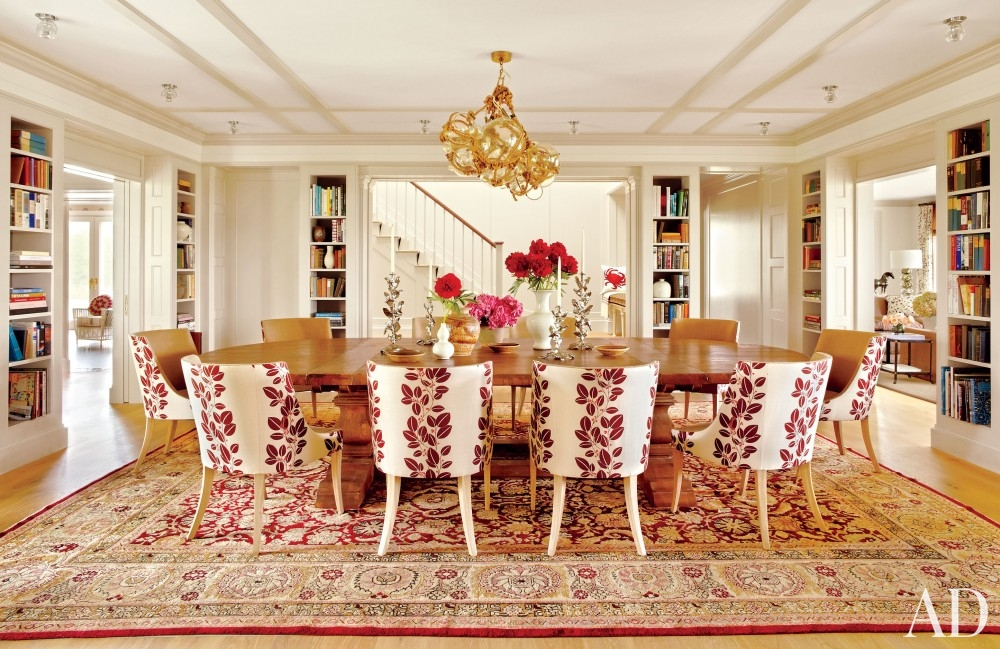 dining room bohemian persian carpet long wood table red white chairs built in bookcases in wall big house honey colored flooring better decorating bible blog artistic lamp chandelier