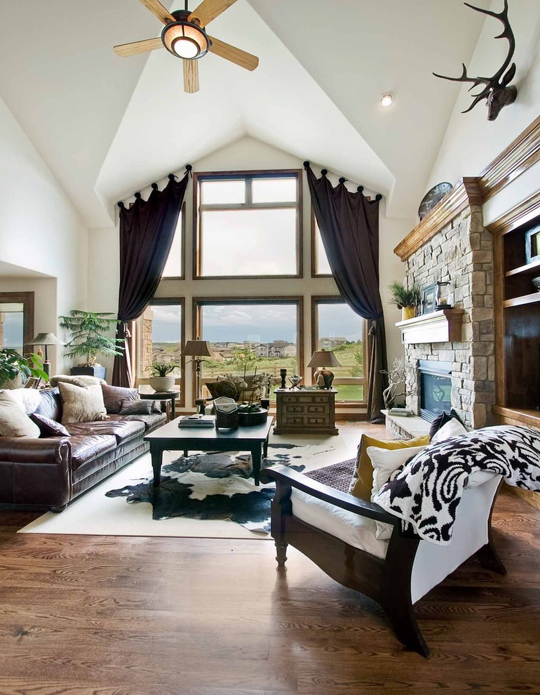 layered cow hide rug sisal rug living room better decorating bible blog leather couch cathedral ceiling antlers on wall country rustic ranch style cottage