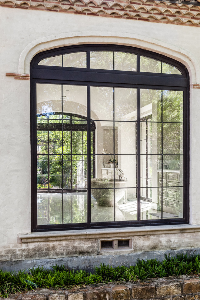 mediterranean-bathroom exterior windows black frame