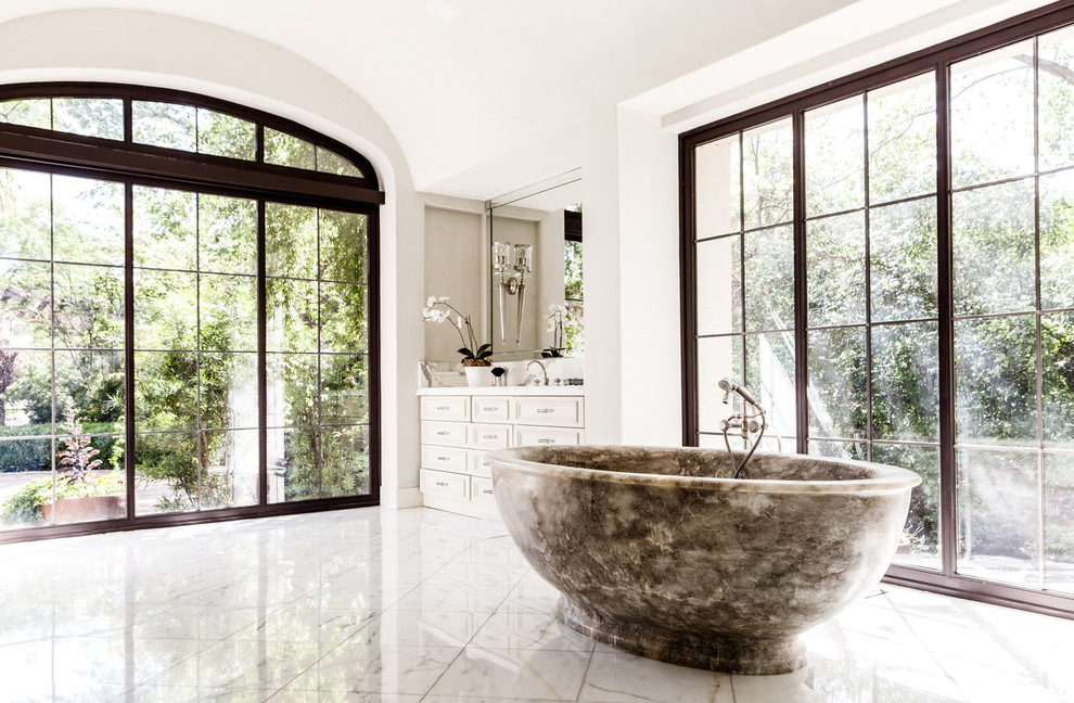 mediterranean-bathroom marble bath tub black frame windows