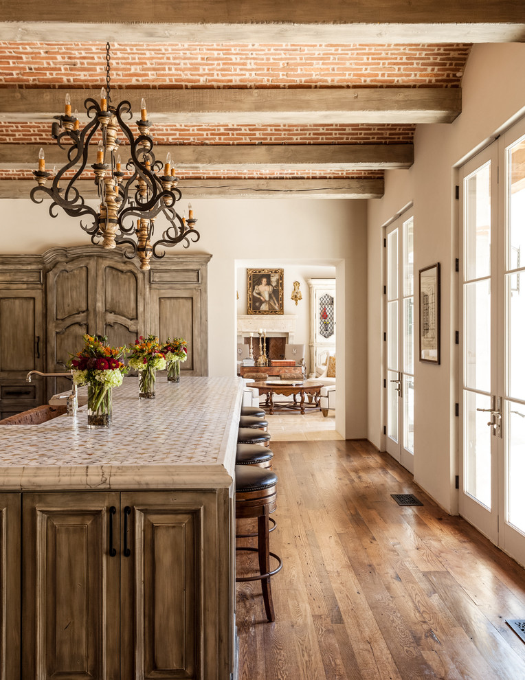 mediterranean-kitchen rustic medieval distressed wood floors brick ceiling wood beams better decorating bible blog