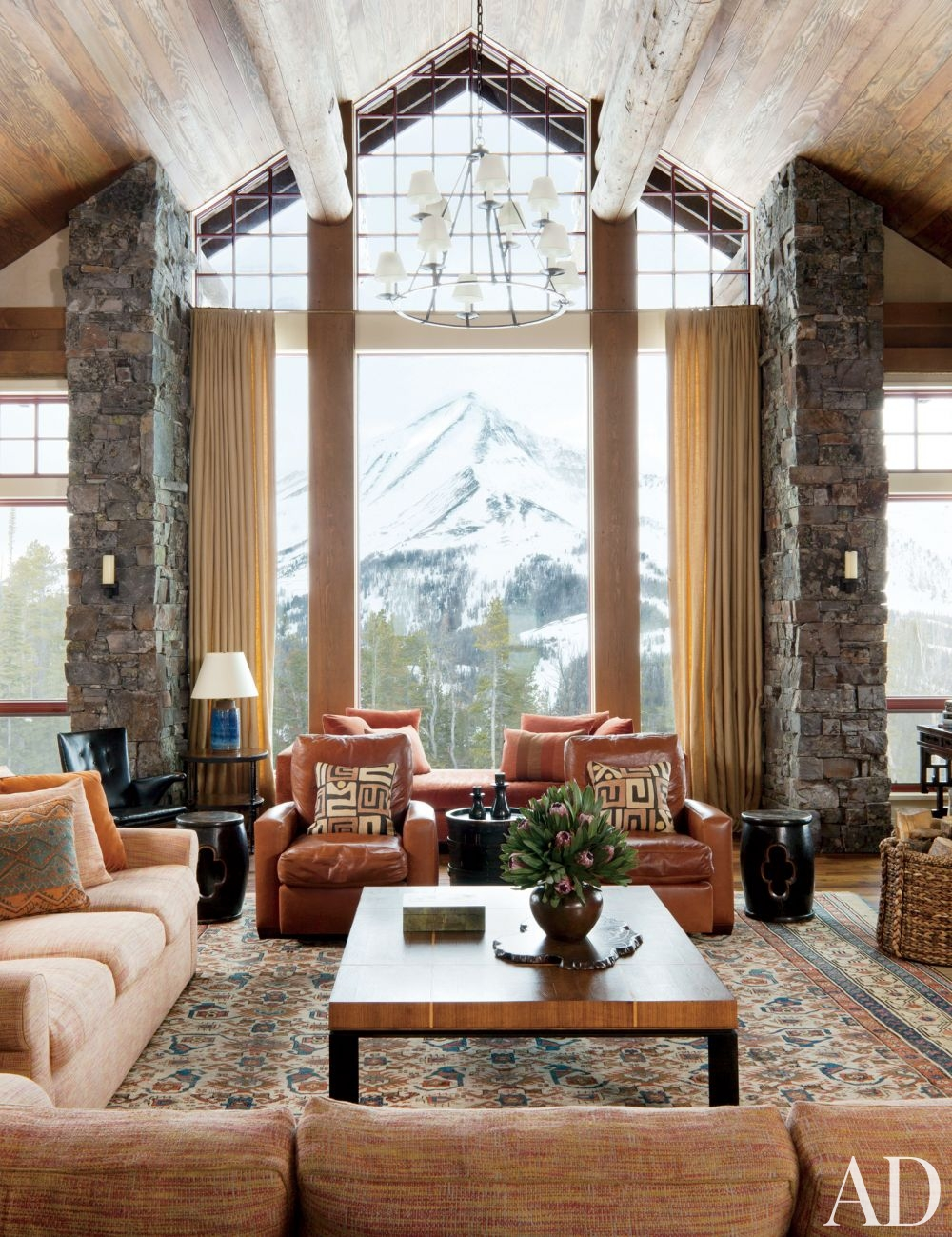 rustic luxury living room persian carpet leather sofas stone wall mountain snow ski lodge decor better decorating bible blog snow lodge