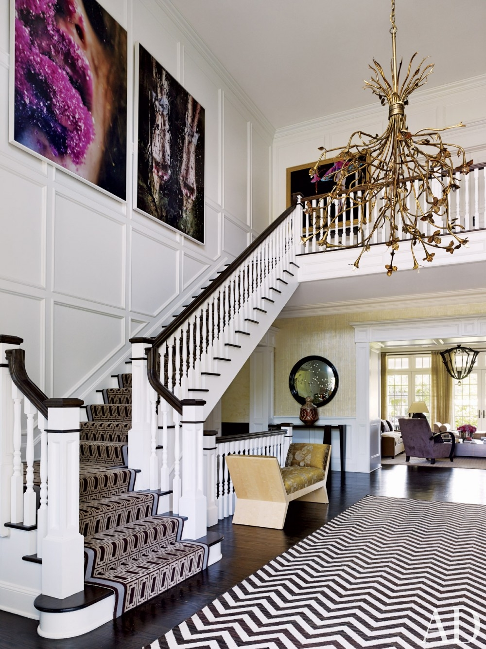 staircase white black dark brown moldings chevrun rug gold chandelier better decorating bible blog interiors