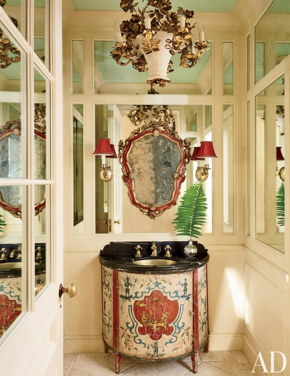 traditional-bathroom-david-easton-inc-palm-beach-florida mirrored wall panels scone lighting gold chandelier