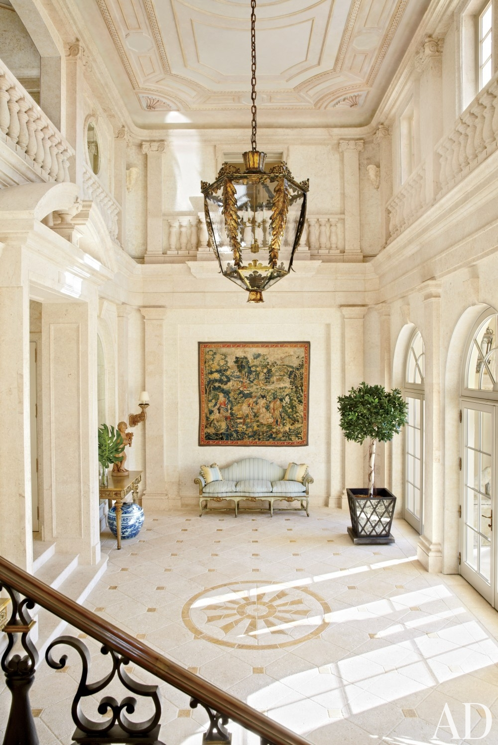 traditional-entrance-hall-david-easton-inc-palm-beach-florida foyer antique kilm on wall