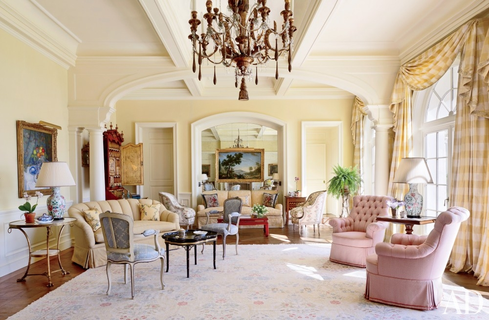 traditional-living-room-david-easton-inc-palm-beach-florida yellow sunny room molding mirrored wall better decorating bible blog