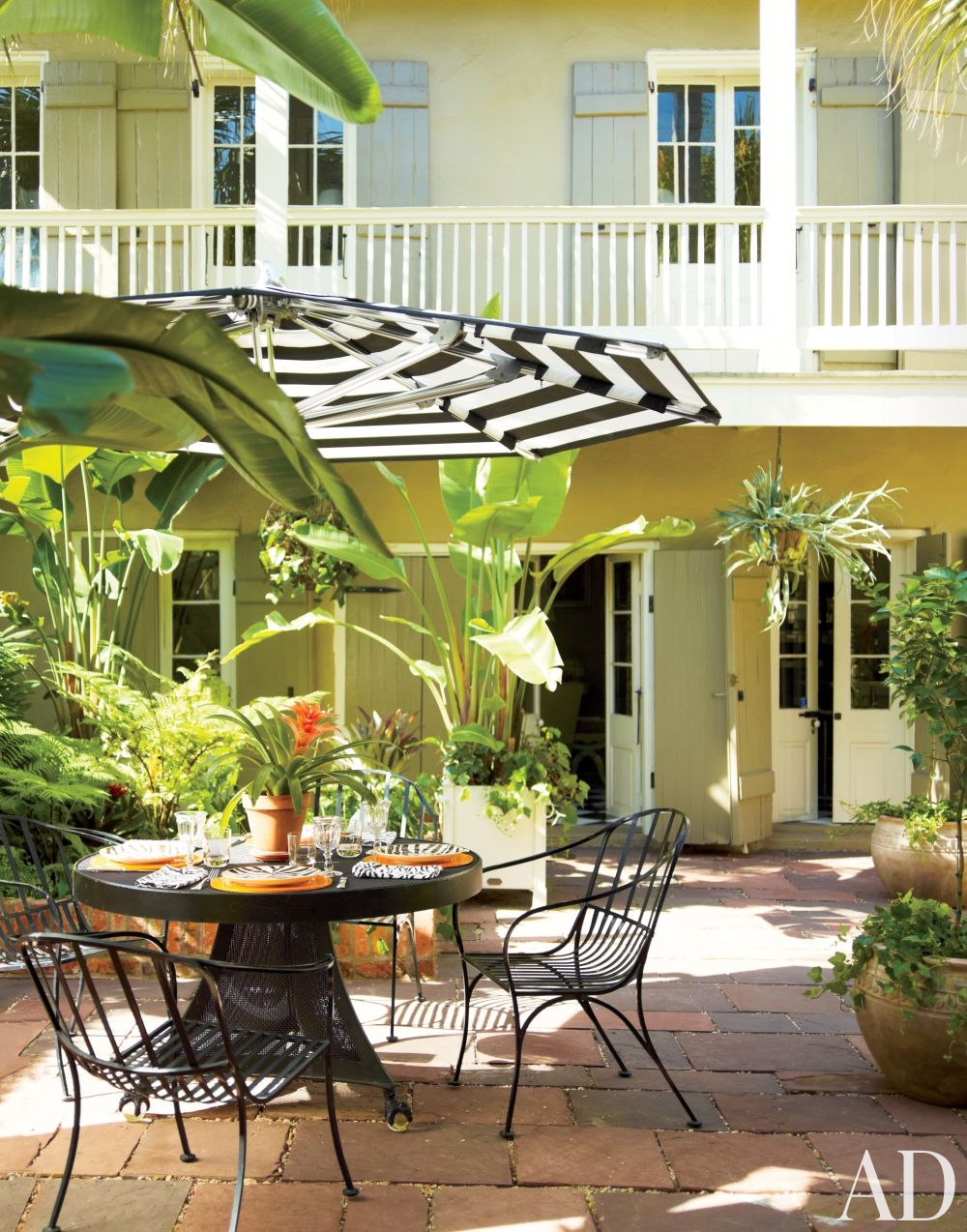 outdoor space striped umbrella garden furniture better decorating bible blog california banana tree palms potted plants
