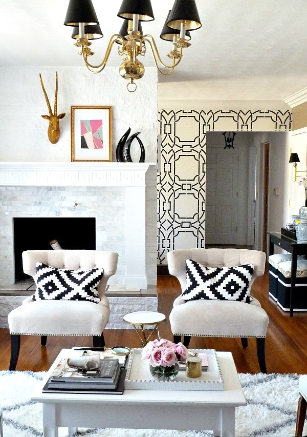 electric home monochrome black white gold decor furry rug chandelier antlers abstract art greek key fire place inlay better decorating bible blog
