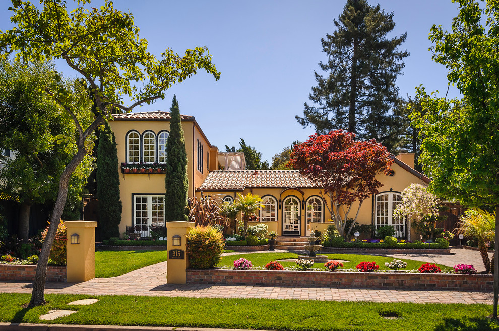 curb appeal ideas for ranch style homes exterior yellow walls raised landscaping