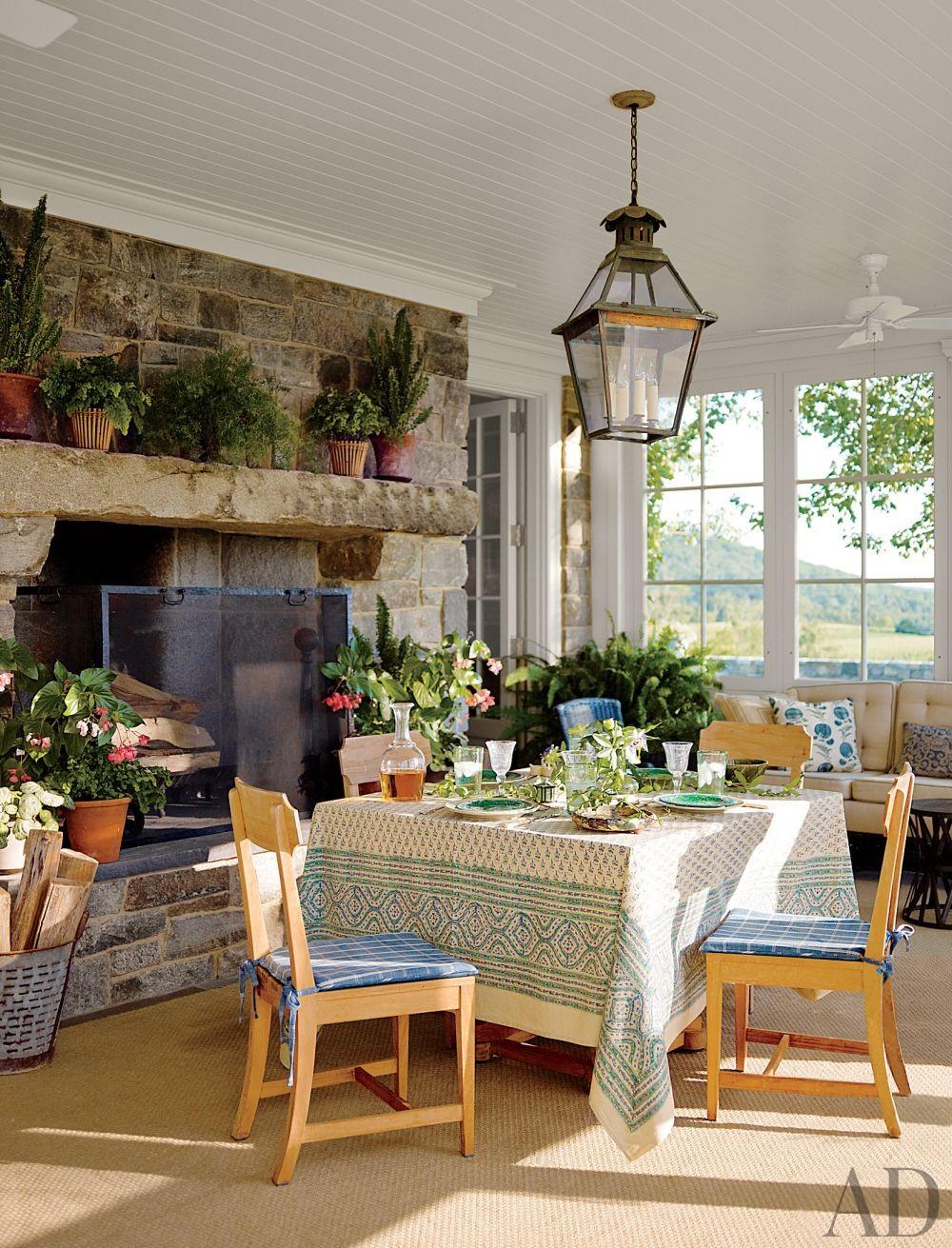 stone fireplace in sunroom decor