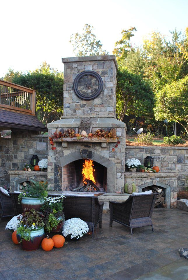 Quick Redecorating Ideas to Enjoy Your Patio in the Fall ... on Outdoor Fireplace Decorations id=20752